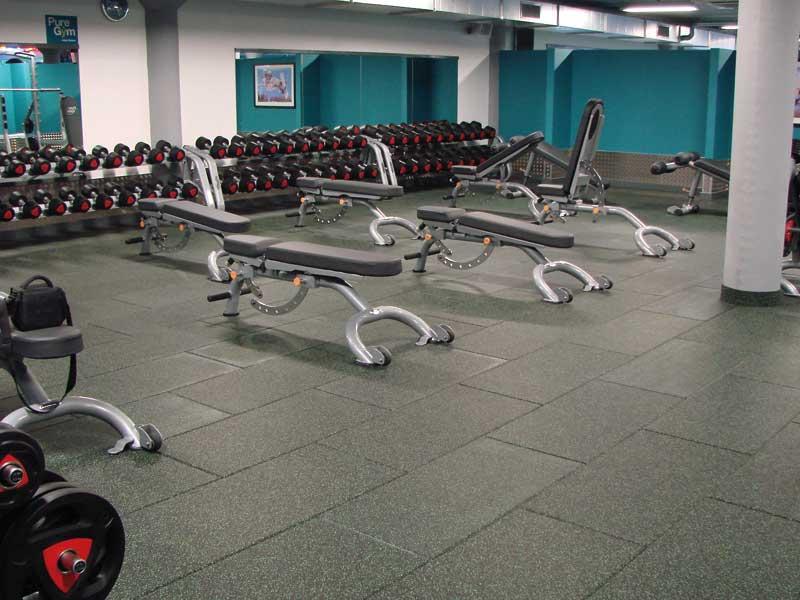 Impact resistant gym floor tiles